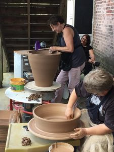 the village potters, asheville, nc, pottery, ceramics, raku, demonstration, fundraiser, extravaganza, kiln opening, scholarship fund