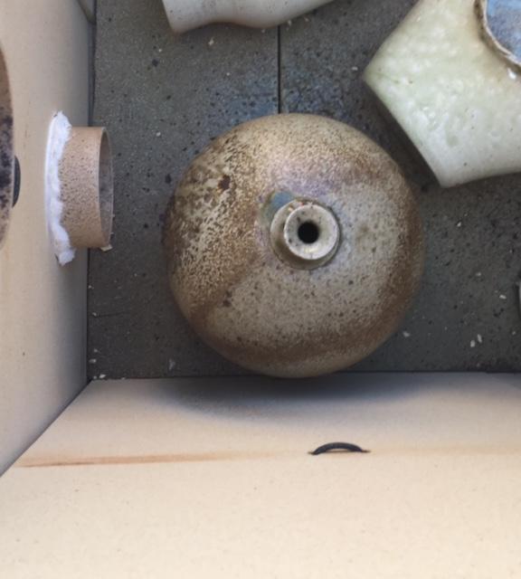 Wood ash blast on pot.