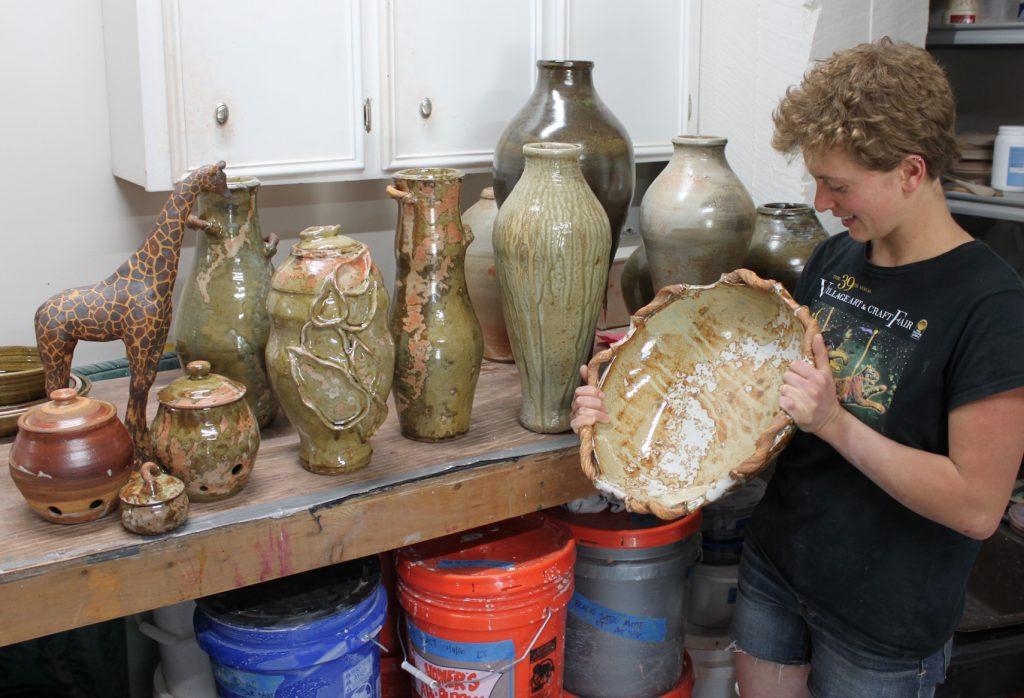 Hannah Looking at Her Pots