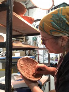 the village potters clay center, asheville, nc, lori theriault, vessels of hope, tvpvoh, it takes a village, sgraffito, carving in clay