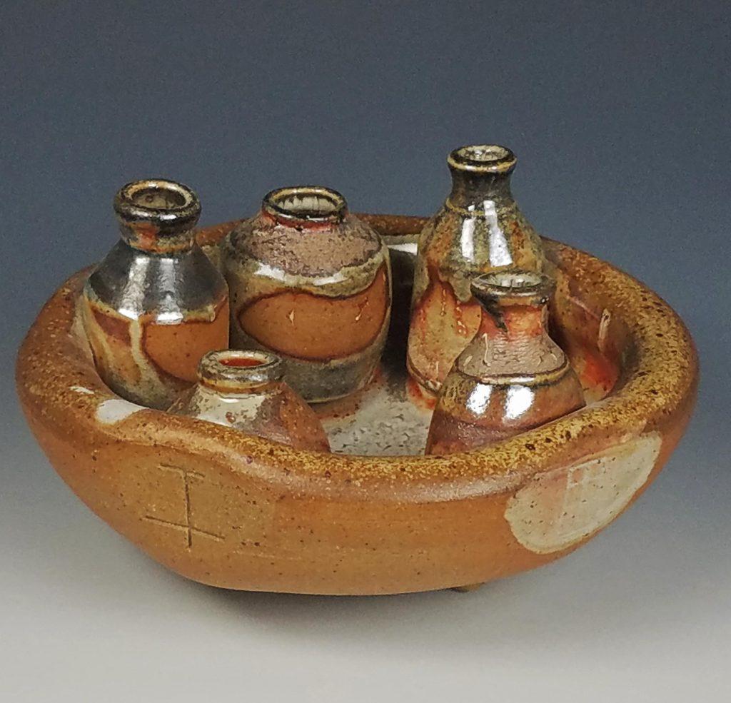 the village potters clay center, asheville, nc, pottery, wheel thrown pottery, wood ash kiln, kazegama, sculpture, julia mann