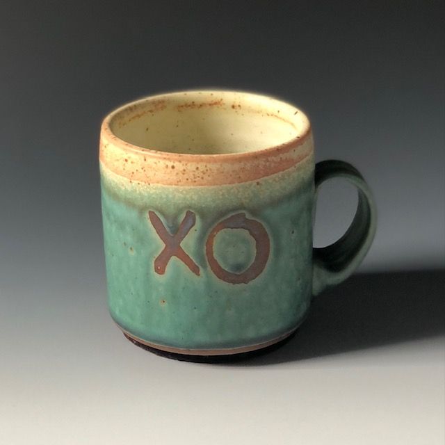 the village potters clay center, asheville nc, pottery, ceramics, wheel thrown pottery, functional pottery, mugs, xo mug, lori theriault