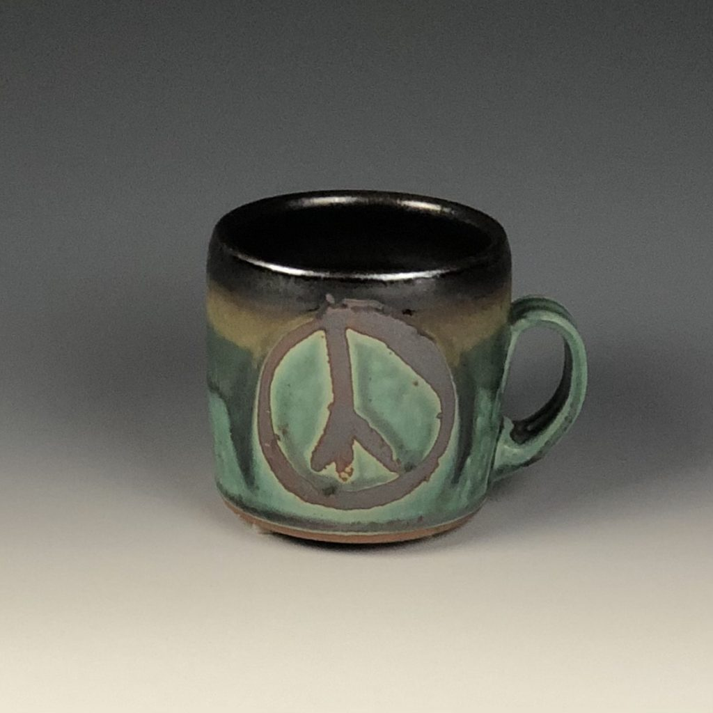 the village potters clay center, asheville nc, pottery, ceramics, wheel thrown pottery, functional pottery, mugs, peace, lori theriault