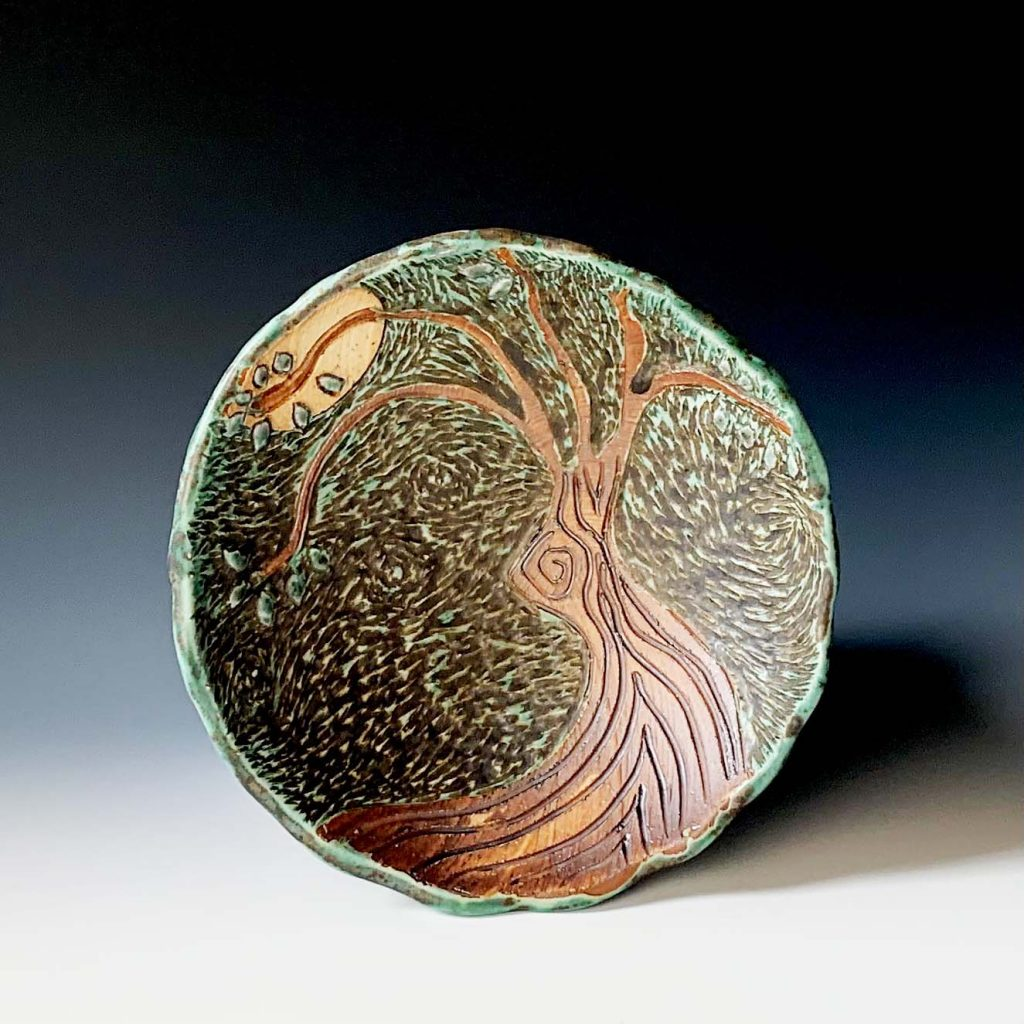 the village potters clay center, asheville nc, pottery, ceramics, carving in clay, vincent series, lori theriault